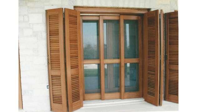 Balcony door with opening glazes, sliding mesh & opening shutters