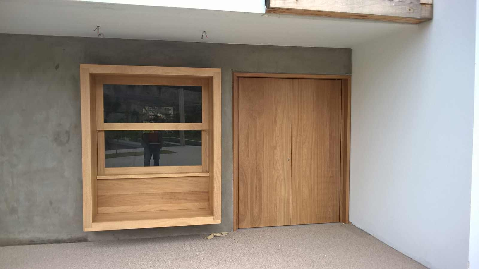 Entrance and retractable window made of solid wood IROCO