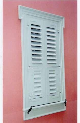 Window with open venetian blinds