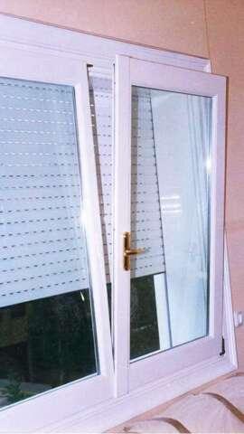 Dual sash tilting window with roller shutter